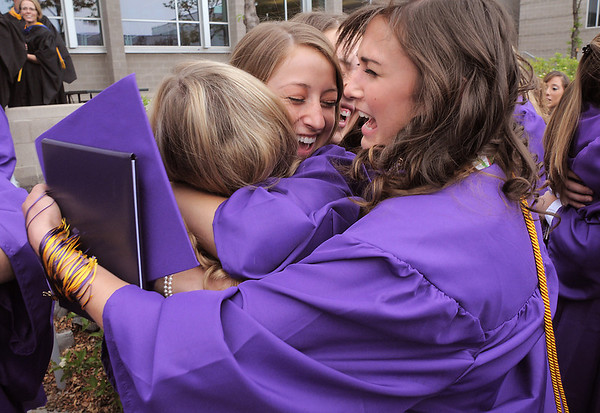 Tiger group hug with Sarah Talamantes, center, Mackenzie Dolan, left, Sierra Williams and Anna Plonski after Wednesday's Holy Family High School graduation ceremony.<br /> May 18, 2011<br /> staff photo/David R. Jennings