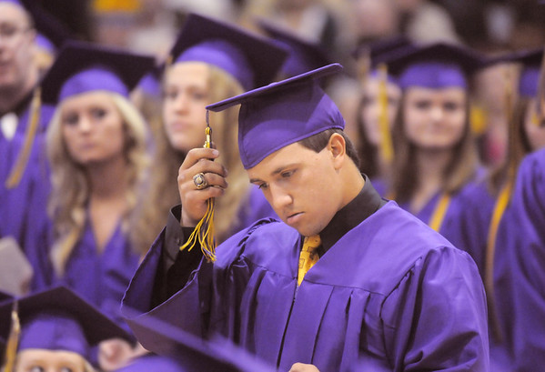 Robert McCandlish prepares to accept his diploma during Wednesday's Holy Family High School graduation ceremony.<br /> May 18, 2011<br /> staff photo/David R. Jennings