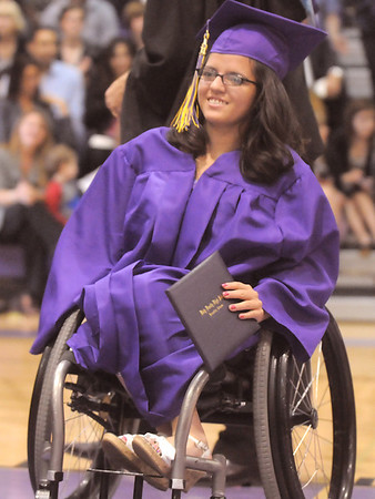 Yaremi Jones carries her diploma during Wednesday's Holy Family High School graduation ceremony.<br /> May 18, 2011<br /> staff photo/David R. Jennings