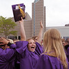 Katie McManus, center, gives a big cheer in the courtyard after Wednesday's Holy Family High School graduation ceremony.<br /> May 18, 2011<br /> staff photo/David R. Jennings