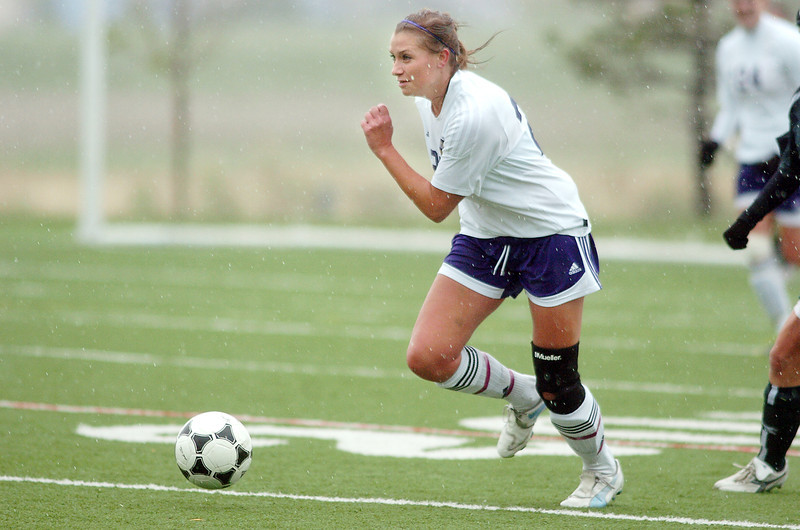 Holy Family's Amy Baumberger moves the ball downfield against Manitou Springs during the state playoff game at the Broomfield County Commons Park on Thursday.<br /> May 19, 2011<br /> staff photo/David R. Jennings
