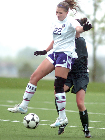 Holy Family's Amy Baumberger moves in front of Lizzie Woldridge, Manitou Springs, during the state playoff game at the Broomfield County Commons Park on Thursday.<br /> May 19, 2011<br /> staff photo/David R. Jennings