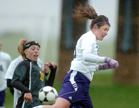 Holy Family's Abby Metzger does a header against Manitou Springs during the state playoff game at the Broomfield County Commons Park on Thursday.<br /> May 19, 2011<br /> staff photo/David R. Jennings
