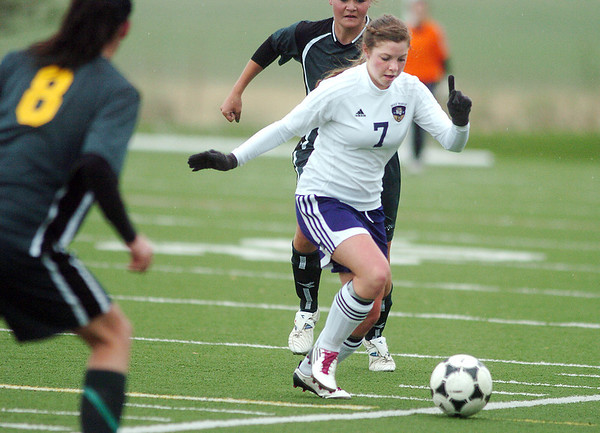 Holy Family's Alexandra Dalton moves the ball against Manitou Springs during the state playoff game at the Broomfield County Commons Park on Thursday.<br /> May 19, 2011<br /> staff photo/David R. Jennings