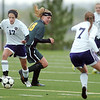 Holy Family's Monica Stokes takes control of the ball from Riley Witham, Manitou Springs, during the state playoff game at the Broomfield County Commons Park on Thursday.<br /> May 19, 2011<br /> staff photo/David R. Jennings