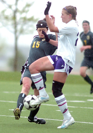 Holy Family's Amy Baumberger fights for control of the ball with Lizzie Woldridge, Manitou Springs, during the state playoff game at the Broomfield County Commons Park on Thursday.<br /> May 19, 2011<br /> staff photo/David R. Jennings