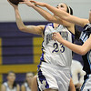 Holy Family's Carolina Gutierrez shoots the ball away from the reaches of a Trinidad player during the Class 3A sweet 16 game at Holy Family on Saturday.<br /> March 5, 2011<br /> staff photo/David R. Jennings