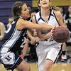 Holy Family's Stephanie goes to the basket against Trinidad's Mellyni Murray during the Class 3A sweet 16 game at Holy Family on Saturday.<br /> March 5, 2011<br /> staff photo/David R. Jennings