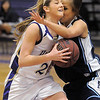 Holy Family's Stephanie Giltner collides with Trinidad's Mellyni Murray while going to the basket during the Class 3A sweet 16 game at Holy Family on Saturday.<br /> March 5, 2011<br /> staff photo/David R. Jennings