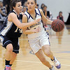 Holy Family's Taylor Helbig drives the ball downcourt against Trinidad's Justine Gallegos during the Class 3A sweet 16 game at Holy Family on Saturday.<br /> March 5, 2011<br /> staff photo/David R. Jennings