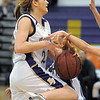 Holy Family's Stephanie Giltner goes to the basket while Trinidad knocks the ball away during the Class 3A sweet 16 game at Holy Family on Saturday.<br /> March 5, 2011<br /> staff photo/David R. Jennings