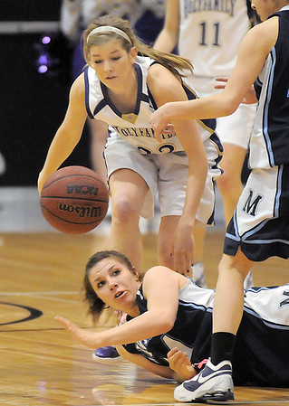 Holy Family's Stephanie Giltner goes after a loose ball from Trinidad's Justine Gallegos during the Class 3A sweet 16 game at Holy Family on Saturday.<br /> March 5, 2011<br /> staff photo/David R. Jennings