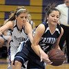 Holy Family's Stephanie Giltner tries to steal the ball from Trinidad's Chelsea Velaquez during the Class 3A sweet 16 game at Holy Family on Saturday.<br /> March 5, 2011<br /> staff photo/David R. Jennings