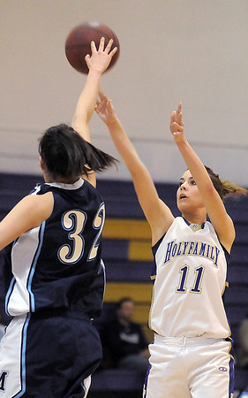 Holy Family's Taylor Helbig shoots the ball to the basket past Trinidad's Janelle Lopez during the Class 3A sweet 16 game at Holy Family on Saturday.<br /> March 5, 2011<br /> staff photo/David R. Jennings