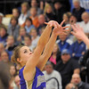 Taylor Helbig, Holy Family,shoots for three against Longmont during Thursday's game at Longmont.<br /> February 3, 2011<br /> staff photo/David R. Jennings