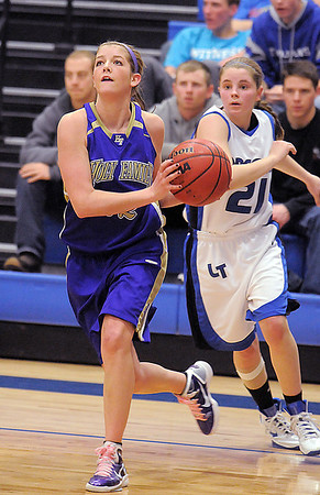 Stephanie Giltner, Holy Family,drives the ball past Longmont to the basket during Thursday's game at Longmont.<br /> February 3, 2011<br /> staff photo/David R. Jennings
