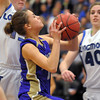 Taylor Helbig, Holy Family, goes to the basket against Longmont during Thursday's game at Longmont.<br /> February 3, 2011<br /> staff photo/David R. Jennings