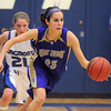 Carolina Gutierrez,  Holy Family, drives down court after recovering a loose ball against Longmont during Thursday's game at Longmont.<br /> February 3, 2011<br /> staff photo/David R. Jennings