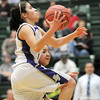Holy Family's Carolina Gutierrez goes for a layup against Pinnacle during Thursday's  great eight games at Moby Gym in Ft. Collins.<br /> March 10, 2011<br />  staff photo/David R. Jennings