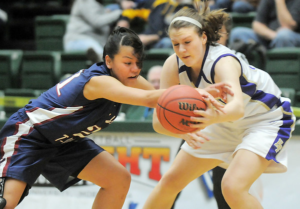 Holy Family's Kassandra Johannsen steals the ball from Pinnacle's Mariah Trinh during Thursday's  great eight games at Moby Gym in Ft. Collins.<br /> March 10, 2011<br />  staff photo/David R. Jennings