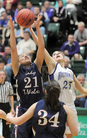 Holy Family's Carolina Gutierrez rebounds the ball from Pinnacle's Mariah Trinh during Thursday's  great eight games at Moby Gym in Ft. Collins.<br /> March 10, 2011<br />  staff photo/David R. Jennings