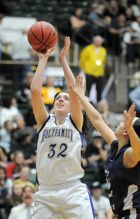 Holy Family's Sierra Williamson shoots against Pinnacle's Dalia Holguin during Thursday's  great eight games at Moby Gym in Ft. Collins.<br /> March 10, 2011<br />  staff photo/David R. Jennings