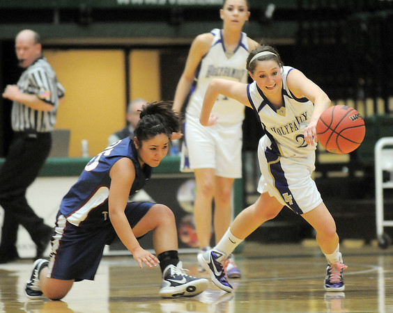 Holy Family's Sarah Talmantes steals the ball from Pinnacle's Alexus Ramirez during Thursday's  great eight games at Moby Gym in Ft. Collins.<br /> March 10, 2011<br />  staff photo/David R. Jennings