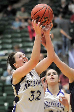 Holy Family's Sierra Williamson rebounds the ball from Pinnacle during Thursday's  great eight games at Moby Gym in Ft. Collins.<br /> March 10, 2011<br />  staff photo/David R. Jennings
