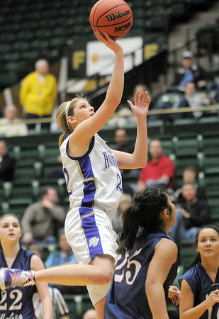 Holy Family's Stephanie Giltner does a layup against Pinnacle during Thursday's  great eight games at Moby Gym in Ft. Collins.<br /> March 10, 2011<br />  staff photo/David R. Jennings