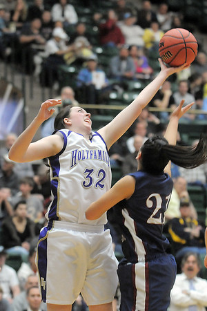 Holy Family's Sierra Williamson rebounds the ball over  Pinnacle's Mariah Trinh during Thursday's  great eight game at Moby Gym in Ft. Collins.<br /> March 10, 2011<br />  staff photo/David R. Jennings