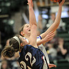 Holy Family's Sarah Talamantes goes to the basket against Pinnacle's Rebecca Kendall during Thursday's  great eight games at Moby Gym in Ft. Collins.<br /> March 10, 2011<br />  staff photo/David R. Jennings