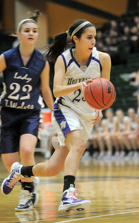 Holy Family's Carolina Gutierrez drives the ball down court past  Pinnacle's Rebecca Kendall during Thursday's  great eight games at Moby Gym in Ft. Collins.<br /> March 10, 2011<br />  staff photo/David R. Jennings