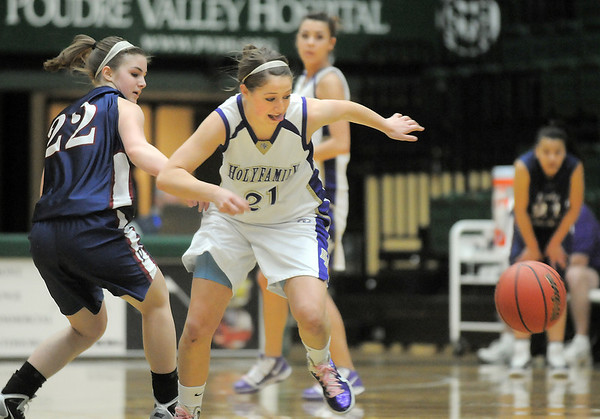 Holy Family's Sarah Talamantes grapples for a loose ball against Pinnacle's Rebecca Kendall during Thursday's  great eight games at Moby Gym in Ft. Collins.<br /> March 10, 2011<br />  staff photo/David R. Jennings