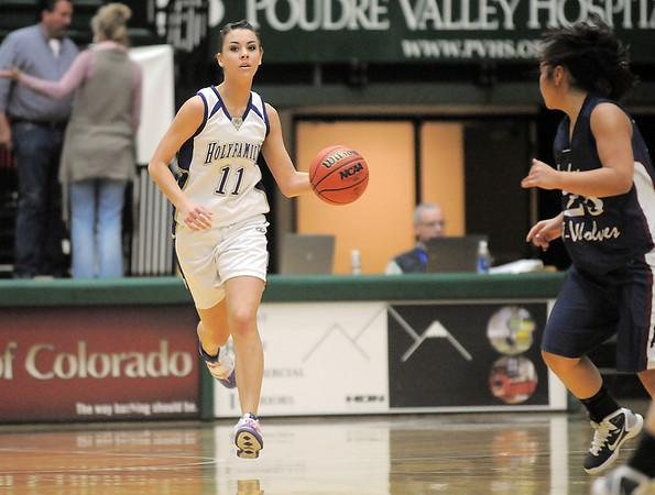 Holy Family's Taylor Helbig drives the ball down court against Pinnacle during Thursday's  great eight games at Moby Gym in Ft. Collins.<br /> March 10, 2011<br />  staff photo/David R. Jennings