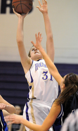 Holy Family's Kassandra Johannsen shoots to the basket against St. Mary's during Saturday's Game at Holy Family.<br /> <br /> January 30, 2010<br /> Staff photo/David R. Jennings