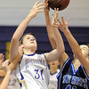 Kassandra Johannsen, Holy Family, fights for the ball with Caroline Parker, St. Mary's, during Saturday's Game at Holy Family.<br /> <br /> January 30, 2010<br /> Staff photo/David R. Jennings