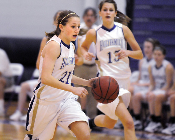 Sarah Talamantes, Holy Family,drives the ball down court against St. Mary's during Saturday's Game at Holy Family.<br /> <br /> January 30, 2010<br /> Staff photo/David R. Jennings