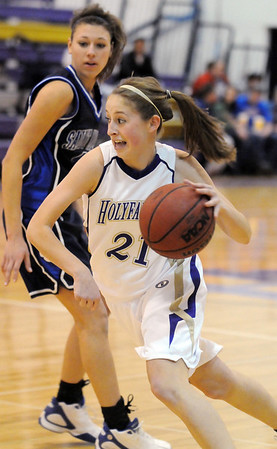 Holy Family's Sarah Talamantes drives the ball past  St. Mary's Elise Miller during Saturday's Game at Holy Family.<br /> <br /> January 30, 2010<br /> Staff photo/David R. Jennings
