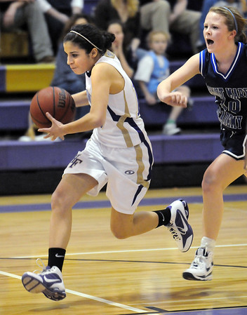 Holy Family's Megan Chavez charges down court past  St. Mary's Hannah Selner during Saturday's Game at Holy Family.<br /> <br /> January 30, 2010<br /> Staff photo/David R. Jennings