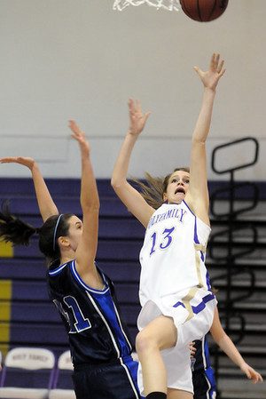 Alex Wilson, Holy Family, shoots to the basket past Caroline Parker , St. Mary's, during Saturday's Game at Holy Family.<br /> <br /> January 30, 2010<br /> Staff photo/David R. Jennings