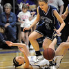 Molly Coogan, Holy Family, collides with Morgan Flynn, St. Mary's, during Saturday's Game at Holy Family.<br /> <br /> January 30, 2010<br /> Staff photo/David R. Jennings