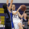 Alex Wilson, Holy Family, goes to the basket past Caroline Parker , St. Mary's, during Saturday's Game at Holy Family.<br /> <br /> January 30, 2010<br /> Staff photo/David R. Jennings