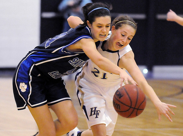 Holy Family's Sarah Talamantes, right,  fights for the ball with Caroline Parker,  St. Mary's, during Saturday's Game at Holy Family.<br /> <br /> January 30, 2010<br /> Staff photo/David R. Jennings