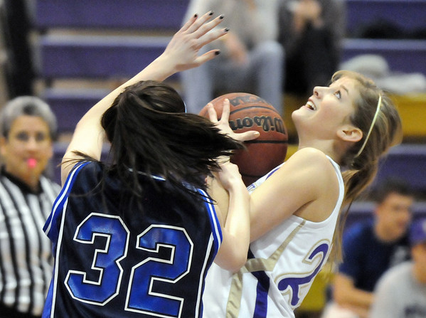 Stephanie Giltner, Holy Family, fights for control of the ball with Johanna Carr, St. Mary's, during Saturday's Game at Holy Family.<br /> <br /> January 30, 2010<br /> Staff photo/David R. Jennings