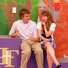 Nick Anderson, left, and Gabby Dalton eat some cookies in the cafeteria after watching their siblings graduate at Wednesday's 85th annual Holy Family HIgh School graduation at Holy Family.<br /> May 19, 2010<br /> Staff photo/ David R. Jennings
