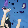 Holy Family graduates toss their hats in the air of the school's courtyard after Wednesday's 85th annual Holy Family High School graduation at Holy Family.<br /> May 19, 2010<br /> Staff photo/ David R. Jennings