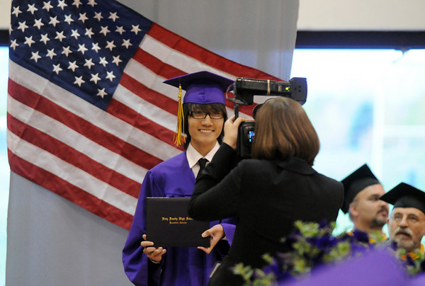 Tu Huu Cao poses for a picture during Wednesday's 85th annual Holy Family High School graduation at Holy Family.<br /> May 19, 2010<br /> Staff photo/ David R. Jennings