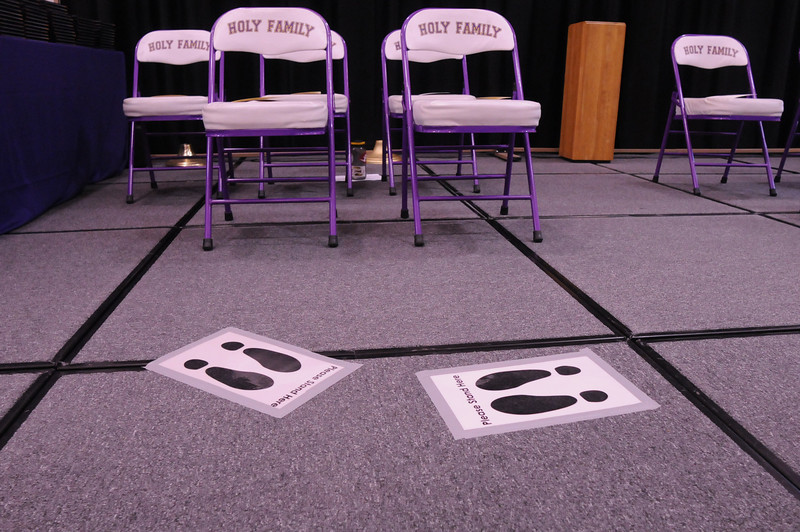 Markers are on the stage for graduates and presenters to be in the proper place for Wednesday's 85th annual Holy Family High School graduation at Holy Family.<br /> May 19, 2010<br /> Staff photo/ David R. Jennings