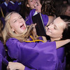 Nicole Roby, left, and Maggie Jurkiewicz celebrate after Wednesday's 85th annual Holy Family High School graduation at Holy Family. Holy Family graduates had 8.5 million dollars in merit scholarships for a class of 139.<br /> May 19, 2010<br /> Staff photo/ David R. Jennings