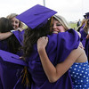 Stacey Harward, right, hugs a fellow graduate before Wednesday's 85th annual Holy Family HIgh School graduation at Holy Family.<br /> May 19, 2010<br /> Staff photo/ David R. Jennings